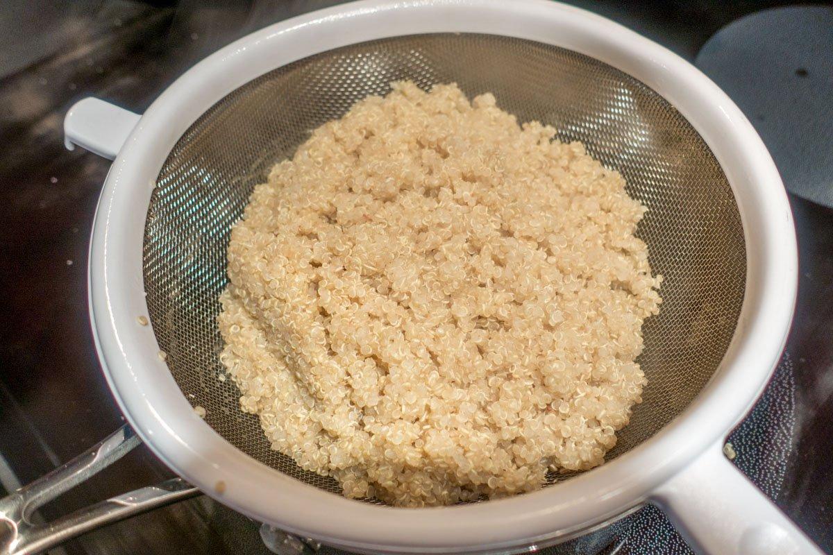 Drain the quinoa for the Mexican casserole