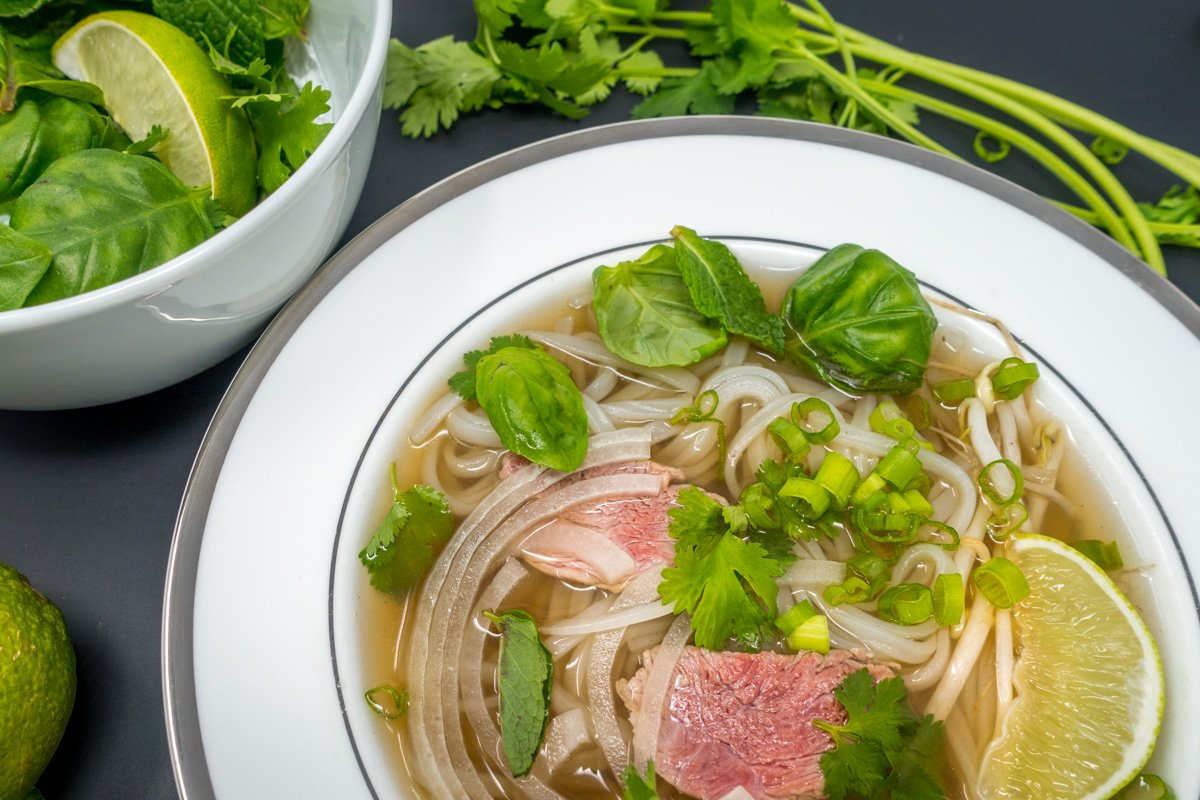The best pho recipe includes flavorful broth, the perfect noodles, and lots of fresh herbs