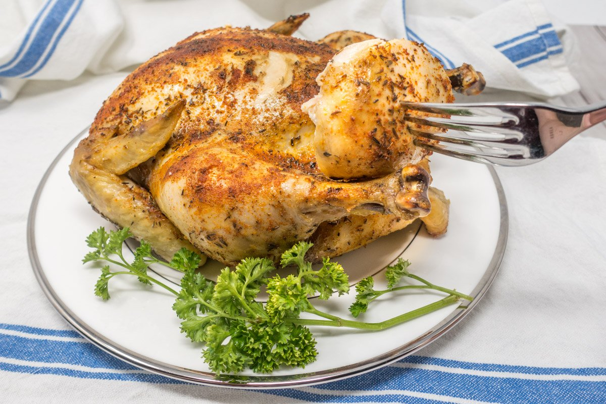 For a delicious dinner with minimal effort, try making this rotisserie chicken in a slow cooker at home.