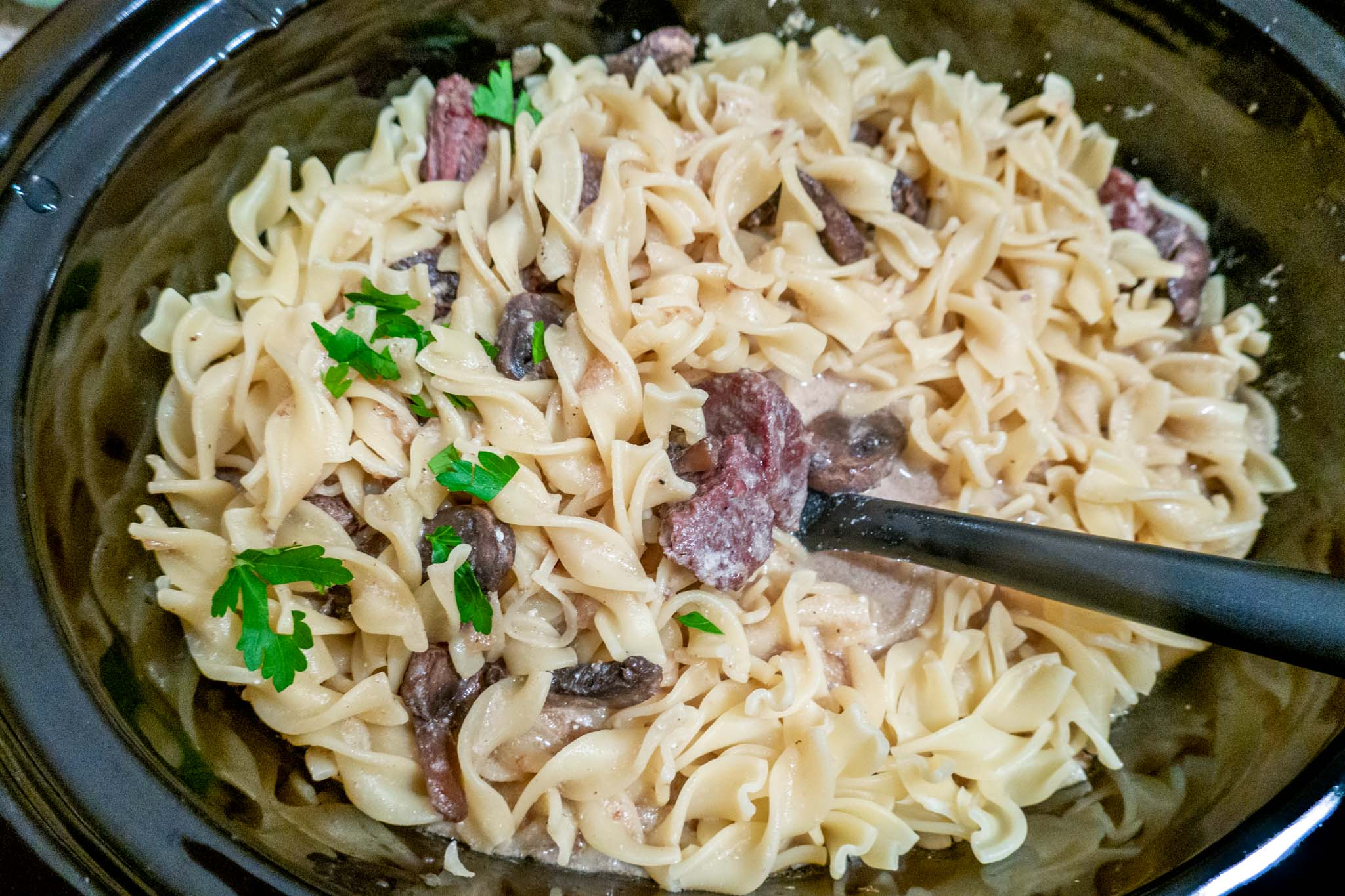 Easy crockpot beef stroganoff combined with egg noodles