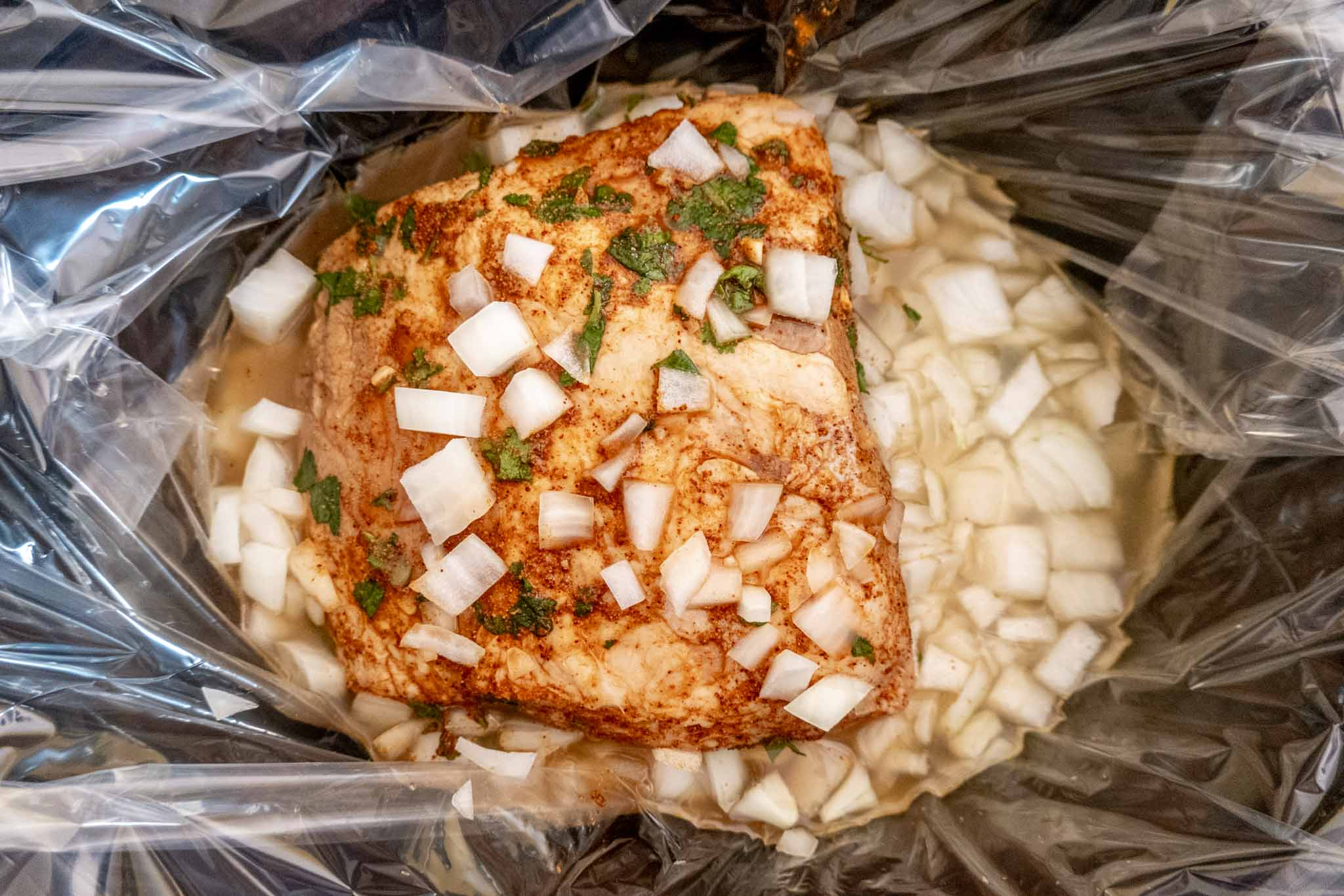 Ingredients for cilantro lime pork in a slow cooker