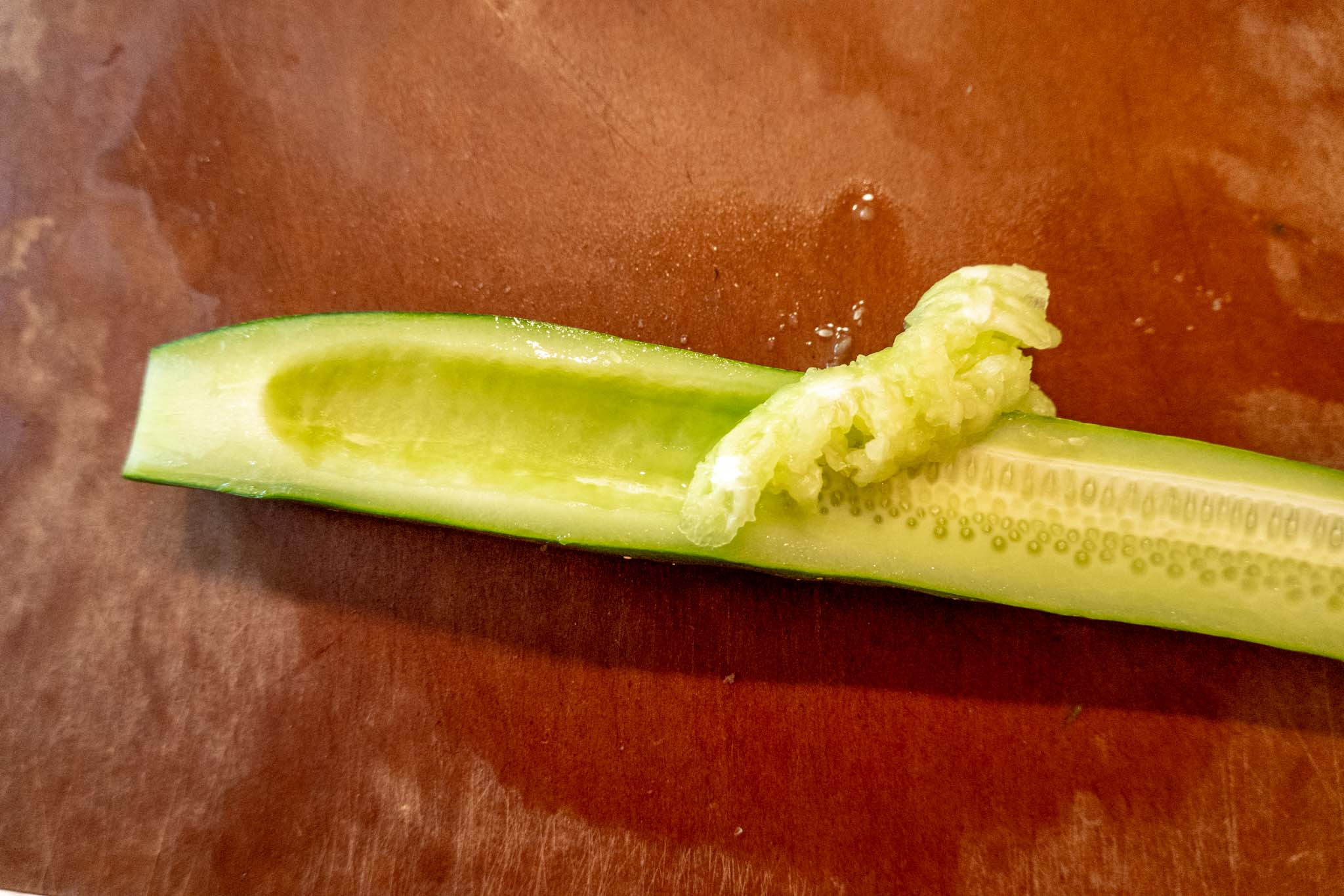 Seeds being removed from a cucumber