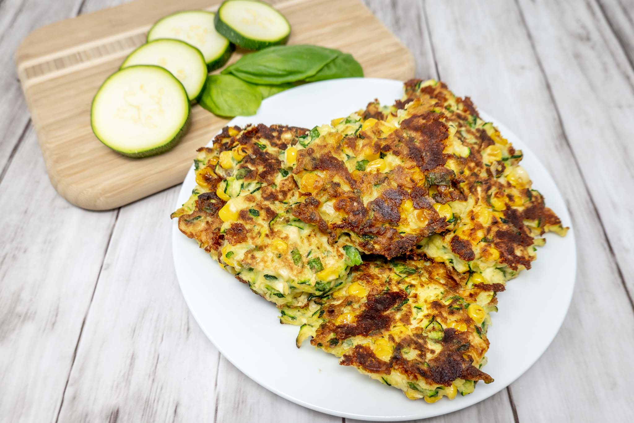 Corn zucchini fritters on a plate