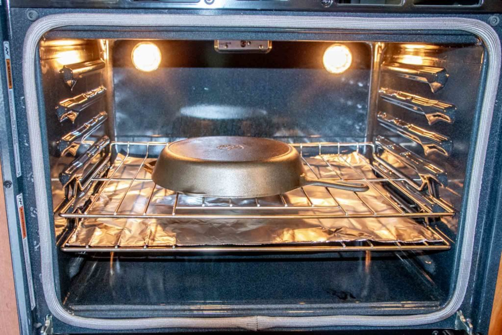 Pan in an oven over a sheet of foil