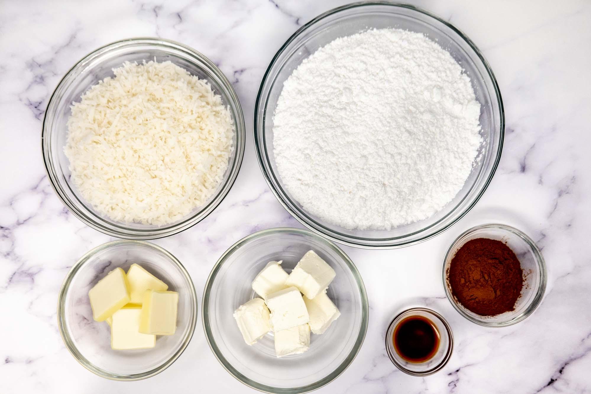 Bowls of shredded coconut, powdered sugar, butter, cream cheese, vanilla, and cinnamon